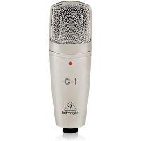 Micrófono de color negro para grabar el sonido de una batería.